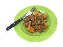 Refeição pequena da carne de assado com a forquilha na placa Imagem de Stock