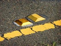 Refelctor van de weg op straat Stock Foto's