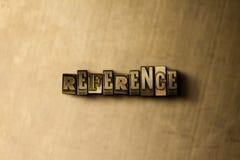 REFERÊNCIA - close-up vintage sujo da palavra typeset no contexto do metal Imagem de Stock