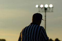 Referee 3. Referee patroling the field stock photography