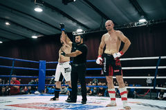 Referee announces victory of MMA fighter. Volgograd, Russia - October 24, 2015: referee announces victory of MMA fighter during Championship of Russia on mixed royalty free stock image
