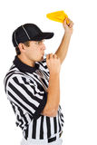 Referee: Blowing Whistle and Throwing Penalty Flag Stock Image