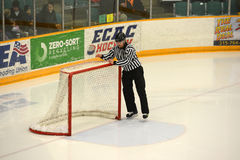 Referee checking Gate in NCAA Hockey Game Stock Photo