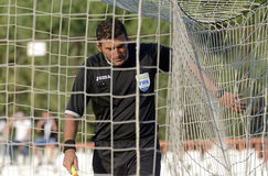Referee checking the goal net Royalty Free Stock Photo