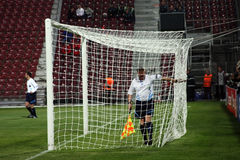 Referee checking the net in Champions League stock photos