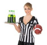 Referee with drinks and rugby in hand Royalty Free Stock Images