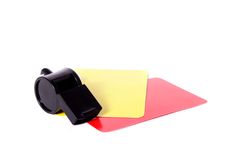 Referee Essentials. Essential objects needed for a football referee consisting a whistle, a red card and a yellow card, isolated on a white background Stock Images