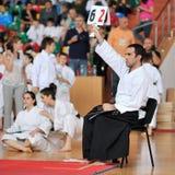 Referee evaluates competitors Royalty Free Stock Photos