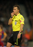 Referee Fernandez Borbalan blowing whistle. During a Spanish League match between FC Barcelona and Real Sociedad at the Nou Camp Stadium on December 12, 2010 in Royalty Free Stock Images