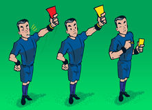 Referee on the filed. A referee giving red card , yellow card, and writing on card , with blowing a whistle Stock Photography