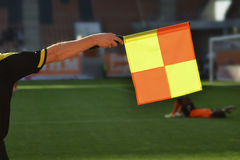 Referee. The flag of assitant referee royalty free stock photo