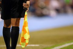 Referee with flag Royalty Free Stock Image