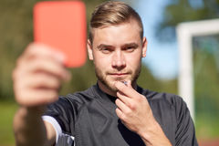 Referee on football field showing red card Stock Image