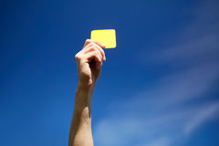 Referee on football field showing yellow card Stock Photography