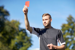 Referee on football field showing yellow card Royalty Free Stock Images