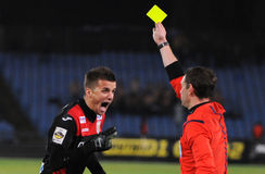 Referee, goalkeeper and yellow card Royalty Free Stock Image