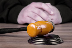 Referee hammer and a man in judicial robes. In court stock image