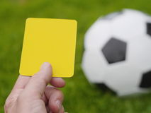 Referee hand with yellow card Stock Images