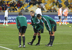 Referee and his assistans warm up Royalty Free Stock Photos