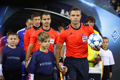 Referee and his assistants go to the pitch Stock Images