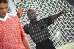 Referee holding out red card Stock Photos
