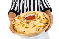 Referee: Holding Platter Of Chips and Salsa Royalty Free Stock Photography