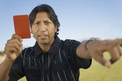 Referee Holding Red Card Royalty Free Stock Images