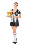 Referee holding tray with beer Royalty Free Stock Photos