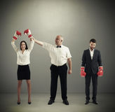 Referee holding winner businesswoman Royalty Free Stock Images