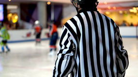Referee in ice hocky game Stock Images