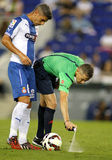 Referee Iglesias Villanueva marks with a Vanishing spray. Referee Iglesias Villanueva marks kick off positions with a Vanishing spray during a Spanish League royalty free stock photography