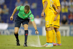 Referee Iglesias Villanueva marks with a Vanishing spray. Referee Iglesias Villanueva marks kick off positions with a Vanishing spray during a Spanish League stock photo