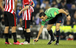 Referee Juan Martinez Munuera marks kick off positions. With a Vanishing spray during a Spanish League match at the Estadi Cornella on March 4, 2015 in royalty free stock image