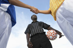 Referee With Opponent Team Players Shaking Hand Against Sky Royalty Free Stock Photos