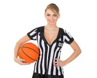 Referee with orange basketball. Female Referee With Orange Basketball In Hand Over White Background Royalty Free Stock Image
