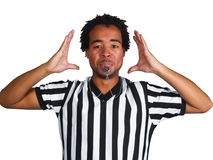 Referee with play gesture. Male African American referee blowing whistle and showing a play gesture Royalty Free Stock Photography