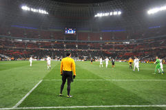 Referee and players on the field Stock Images