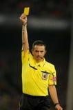 Referee Ramirez Dominguez delivers yellow card Stock Photos