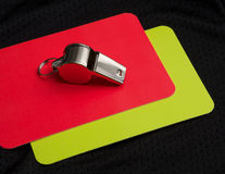 Referee red card and whistle Stock Photography