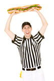 Referee: Ref Holds Huge Sandwich in Air Royalty Free Stock Image