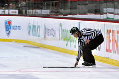 Referee selects a broken stick Stock Photo