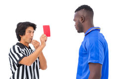 Referee sending off football player Stock Images