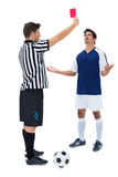 Referee sending off football player Stock Photography