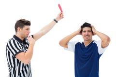 Referee sending off football player Stock Image
