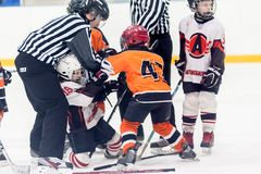 Referee separates fighting players Royalty Free Stock Image