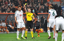 Referee show yellow card Stock Images
