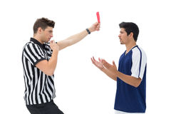 Referee showing red card to football player Stock Images