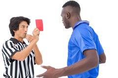 Referee showing red card to football player Royalty Free Stock Image