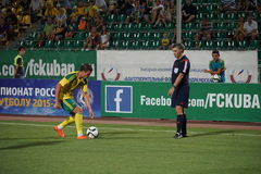 The referee shows a midfielder of FC Kuban Sergei Tkachev with a place to break free kick Royalty Free Stock Photography
