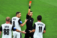 The referee shows a red card to the player Royalty Free Stock Image